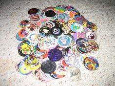 "Pogs is the circular version of ""teks."" School-age children from the late '80s and early '90s grew their pogs collection also by playing with their peers. The game requires getting the same number of pogs from each player and forming a stack. After a few throwing and slamming, each winning player will get their share of the pogs that land face up.The name ""pogs"" is believed to have originated from a brand of juice called POG (short for passion fruit, orange, and guava), bottle caps used to…"