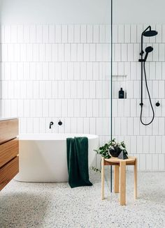 This Big Bathroom Trend Turns Traditional Subway Tile on Its Head -- Horizontal offset. White Subway Tile Bathroom, Subway Tiles, White Tiles, Bathroom Trends, Bathroom Renovations, Home Remodeling, Bathroom Ideas, Bathroom Makeovers, Bathroom Designs