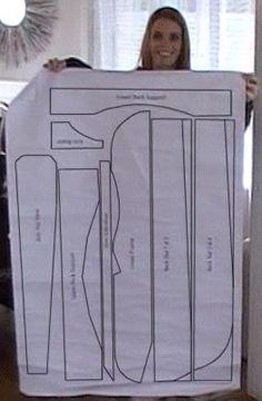 Angela holding up the full size adirondack template #woodworkingplans