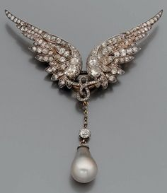 A 19th century gold, silver and diamond brooch. Designed as two wings in the style of Valkyrie's headgear, entirely set with old- and rose-cut diamonds, connected to the centre by a line of interlaced small rose-cut diamonds, suspending a grey pearl drop surmounted by an old-cut diamond.