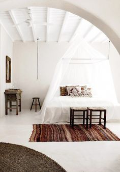 White beams against matching white ceilings make these spaces the epitome of serene and peaceful. These tonal, white-on-white interiors have the air of Greek island hideaways–never a bad thing, in our book.