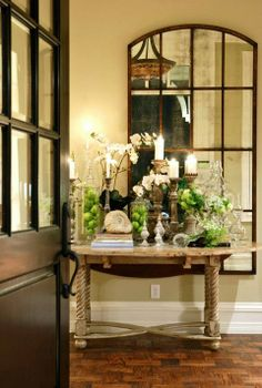 Love the mirror! Use the old window pane insert to make a mirror like this one to hang in the entryway. Love the vignette with candles and fruit.