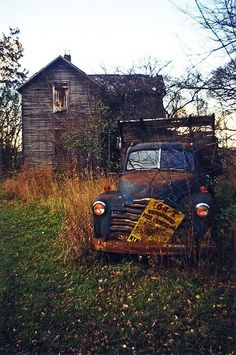 old house old truck Someone had dreams here  but left them behind for some reason known only to them