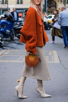 Burnt orange coat with taupe tones for boots and skirt! Can we just say best dressed?!