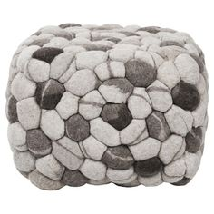 Found it at AllModern - Fiona Pouf Ottoman in White & Gray http://www.allmodern.com/deals-and-design-ideas/p/Eclectic-Minimalist-Living-Fiona-Pouf-Ottoman-in-White-%26-Gray~YA24738~E15981.html?refid=SBP.rBAZEVMRSHXAKixEYY39AhLBMdhND0D2hMJG8e5PLqs
