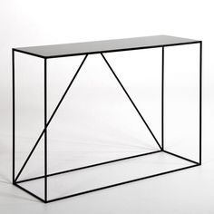 Romy Metal Console Table. This elegant, understated metal console table homes in on clean lines fitting seamlessly into any interior. Ideal in a hallway, lounge or even a bedroom to show off a lamp, vase or any stylish decorative object! Size: L 120 x D 40 x H 85 cm. In black epoxy coated metal.