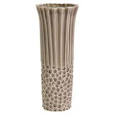 """I like the texture in this tall vase. Fluted ceramic vase with textured base detail.  Product: VaseConstruction Material: CeramicColor: BeigeDimensions: 19.75"""" H x 8.25"""" Diameter"""