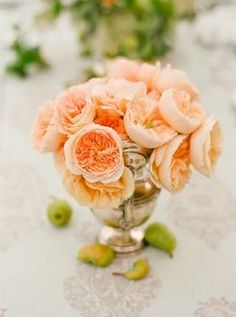 peach garden rose centerpiece in mercury glass vase....We can make faux mercury glass centerpieces for you!
