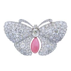 Rare Belle Epoque Platinum Diamond and Conch Pearl Butterfly Brooch, 8 Carats of Diamonds (the center Antique Cushion Cut Diamond is about 1 Carat). Beautifully hand fabricated with complete back azuring. The Conch Pearl is 4 Carats. United States, circa 1900. 1stdibs.com.