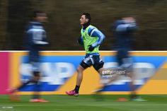 Mesut Oezil runs during a Germany training session ahead of their Euro 2016 Qualifier against...