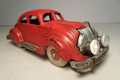 a 1936 Hubley Cast Iron Chrysler Airflow Sedan.