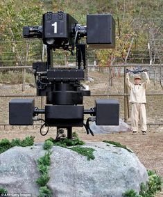 The machine-gun wielding robots, built by Samsung, have heat and motion detectors to identify potential targets more than 2 miles away.