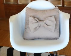 DIY: Big Bow Pillow | Say Yes to Hoboken // SUPER cute accent pillow, and very easy to make. Nothing but straight seams to sew. Sturdy enough to be dragged around by a toddler, too. :) I love it in that neutral brownish grayish color--keeps it from being too girly.