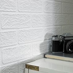 """Brick walls offer a fabulous sense of texture to a room. If you aren't fortunate enough to have the architectural element in your home already, opt for a """"brick-look"""" wall covering like this one from Graham and Brown."""