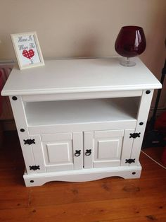 Corona Mexican Pine tv unit, post makeover. Painted white and protected with wax