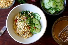 Rice Noodle Salad in Sesame Paste, Peanut, Soy, Sesame Oil, Brown Sugar, Ginger, Garlic, and Chile Garlic Rice Vinaigrette with Cucumber, Roasted Peanuts, Mint, and Cilantro