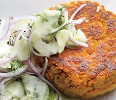 "Chickpea–Sweet Potato Burgers With Dilly Cucumbers. ""Hearty sweet potatoes and chickpeas create a burger that's about as meaty as it gets without using any meat. Dried chickpeas keep these patties crispy; soak them overnight so they're ready to cook when you are."" Vegan"
