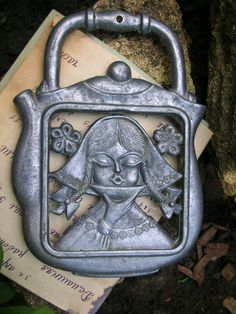 Beautiful VINTAGE GIRL drinking tea TRIVET, uncertain if cast iron, comes from Russia.