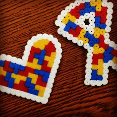 Pins made from Perler beads for autism awareness