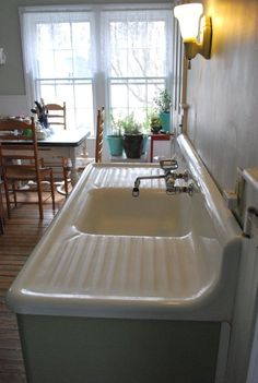 Antique white porcelain cast iron kitchen sink with double drainboard #AmericanRadiatorandStandardSanitaryInc