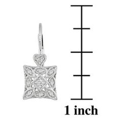 @Overstock - A gorgeous mosaic tile look characterizes these exquisite diamond earringsFashioned in polished white gold21 round diamondshttp://www.overstock.com/Jewelry-Watches/Miadora-10k-White-Gold-and-1-6ct-Diamond-Dangle-Earrings/1797764/product.html?CID=214117