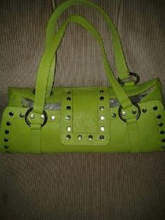 Maurizio. Taiuti. Genuine leather made in. Italy handbag for woman. V beautiful. Pretty. Free ship