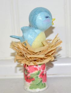 This sweet bluebird was handmade by me with paper clay! She is sitting pretty in her little nest with a spool for the base. She is hand painted by