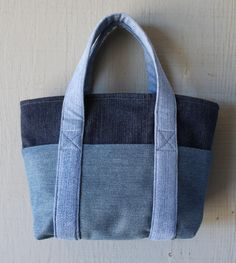 Denim Zipper Top Small Tote Handbag with Six Outside Pockets, Denim Straps and Lined with a Soft Muted Blue Cotton Fabric by AllintheJeans on Etsy