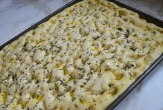 Perfect for feeding a crowd, focaccia is a flavorful and easy-to-make Italian flat bread baked in a sheet pan. It's made with a yeast dough that rises twice: once before it is shaped and then again after it is shaped (so be sure to allow plenty of time). To give the bread its signature dimpled appearance, little indentations are formed all over the dough, which …