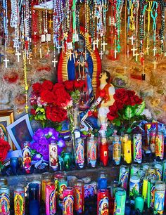 Shrine in Chimayo, New Mexico by Ivan Kaminoff, via Flickr  -Love rosaries hanging from beds and statues and religious candles from the grocery store.  Have them around the house,