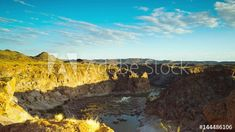 Stock Footage of Motion controlled timelapse sunrise over the gorge at Ararat in Augrabies Falls National park looking down onto the Orange River, with clouds moving, linear from left to right available on request. Explore similar videos at Adobe Stock Augrabies Falls, Rock Formations, Geology, Stock Video, Stock Footage, Grand Canyon, Sunrise, National Parks, Clouds