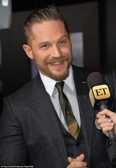 All smiles: The British actor seemed to be in good spirits during an interview...