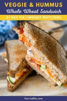 Whole Wheat Veggie Hummus Sandwich | 21 Day Fix #wholefoods #21dayfix #portionfix #healthyeating #sandwich #carrieellefood #easyrecipe Hummus Sandwich, Veggie Sandwich, Sandwich Ideas, Lunch Recipes, Whole Food Recipes, Dinner Recipes, Healthy Recipes, 21 Day Fix Vegetarian, Aldi Meal Plan