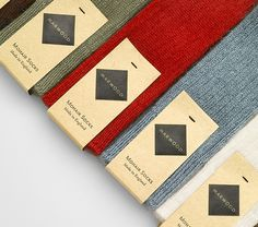 Logo and mixed fibre label design by Everything In Between for London-based tie and neckwear brand Marwood.