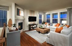 We ♥ this open living room with lively pops of color! What do you think!? #livingroom #familyroom #decor @lennarhomes