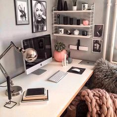 Small pink accents. Medium simple white desk. Cute and chick drawings. Maybe a white rug on chair?...