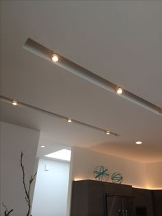 Clean and minimalist white ceiling with integrated lighting