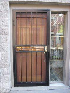Wrought iron security door outside pinterest wrought for Custom storm doors