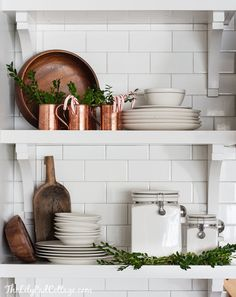 White dish set, with metal and wood cooking utensils and miscellaneous cooking things.