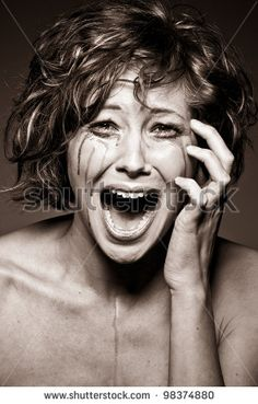 stock photo : a portrait of a crying brunette