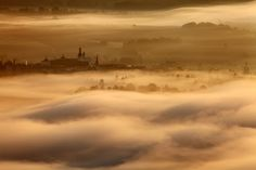 Ethereal feel in this landscape of a monastery in Broumov, Czech Republic Around The World In 80 Days, Around The Worlds, Prague, Eastern Europe, Worlds Of Fun, Earth Tones, Nature Photos, Beautiful Places, Clouds