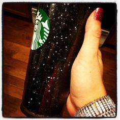 Spray Glue & Black Glitter inside an insulated Starbucks Cup!  Buy cup, unscrew it, spray outside of inner cup with Glitter...any color!  Let dry and then screw cup back together! TA DA!!!