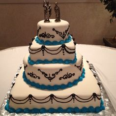 Turquoise & black wedding cakes with scroll work