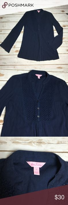 Navy blue long sleeve Lilly Pulitzer top This top is 100% cotton, it has a patch of floral lace at the neckline chest area. It also can half unbutton. Very flattering and belle style sleeves so they get a bit larger as they approach the wrist. I ❤️ offers! Lilly Pulitzer Tops