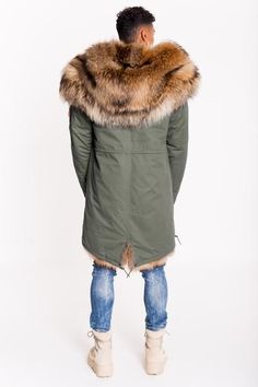 The ultimate luxury parka. The khaki shell has been updated by combining the luxurious super thick Raccoon fur hood trim and super thick front fur edges as well