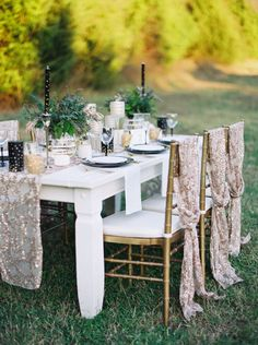 Look no further for outdoor wedding ideas! This reception table is decorated with sequins and metallics.