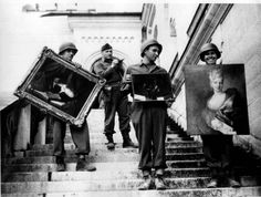 The Monuments Men – Capt. James Rorimer (second from left), who later would become the director of the Metropolitan Museum of Art, supervises the safeguarding of art stolen from French Jews and stored during the war at Schloss Neuschwanstein Castle in southern Bavaria, ca. April 1945.