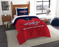 """Super comfy and soft, this OFFICIAL NBA """"""""Soft & Cozy"""""""" Twin Comforter Set by The Northwest Company will make you never want to get out of bed! The large team logo stands out from the solid background on this bold bedding fit for a true fan. Toronto Raptors, Twin Comforter Sets, Bedding Sets, Duvet, Chicago Blackhawks, Chicago Bulls, Nba Bulls, Nhl Chicago, American Football"""