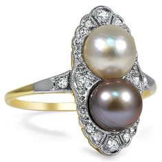 Two large cultured pearls, one white, one gray sit on a bed of diamond accents in this unique cocktail ring from the Art Deco era (approx. 0...
