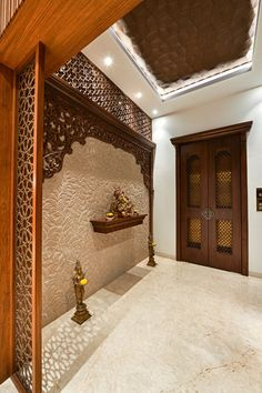 Home Discover Rejuvenating sundowner modern corridor hallway & stairs by ar. Living Room Partition Design, Pooja Room Door Design, Room Partition Designs, Hallway Designs, Foyer Design, Home Room Design, Home Interior Design, Wooden Partition Design, Wooden Ceiling Design